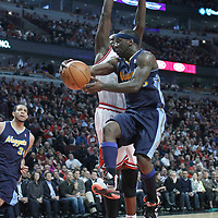 26 March 2012: Denver Nuggets point guard Ty Lawson (3) passes the ball to Denver Nuggets center JaValee McGee (34) around Chicago Bulls small forward Luol Deng (9) during the Denver Nuggets 108-91 victory over the Chicago Bulls at the United Center, Chicago, Illinois, USA. NOTE TO USER: User expressly acknowledges and agrees that, by downloading and or using this photograph, User is consenting to the terms and conditions of the Getty Images License Agreement. Mandatory Credit: 2012 NBAE (Photo by Chris Elise/NBAE via Getty Images)