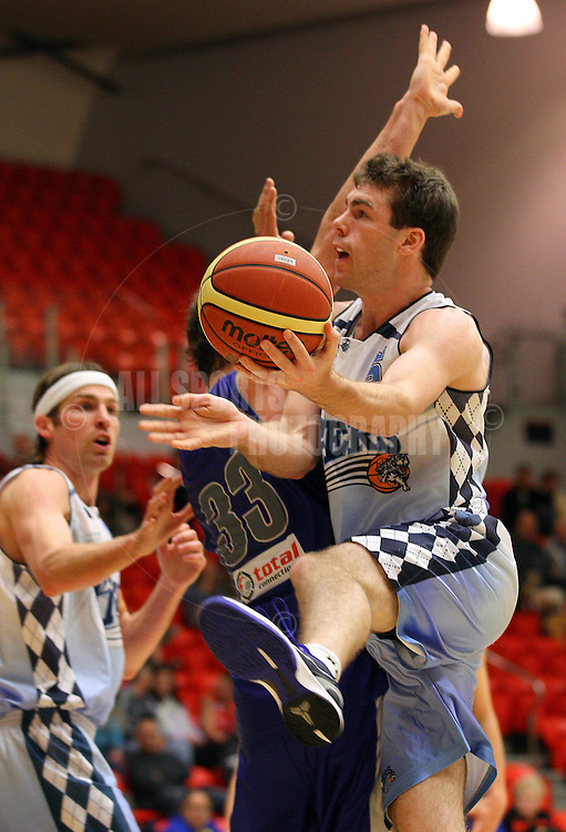PERTH, AUSTRALIA - JULY 16: Rob Cassir of the Tigers lays up during the week 18 SBL game between the Perry Lakes Hawks and the Willetton TIgers at The State Basketball Center on July 16, 2011 in Perth, Australia.  (Photo by Paul Kane/Allsports Photography)