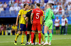 Referee Bjorn Kuipers tries to keep the players calm as tempers flare during the FIFA World Cup, Quarter Final match at the Samara Stadium.