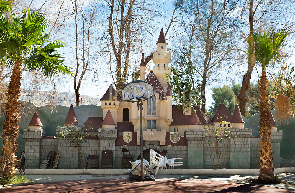 Desert Hot Springs-abandoned hotel and holiday complex with basketball court in front of a minature fairy castle