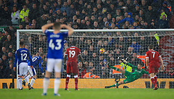 Everton's Wayne Rooney scores his side's first goal of the game from the penlaty spot during the Premier League match at Anfield, Liverpool.