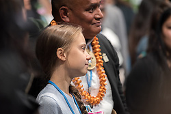 9 December 2019, Madrid, Spain: Greta Thunberg poses for a photo with a man from Tonga, as she attends COP25 in Madrid.