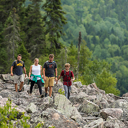 A family hikes on the Loop Trail next to Deboullie Pond in Aroostook County, Maine. Deboullie Public Reserve Land.