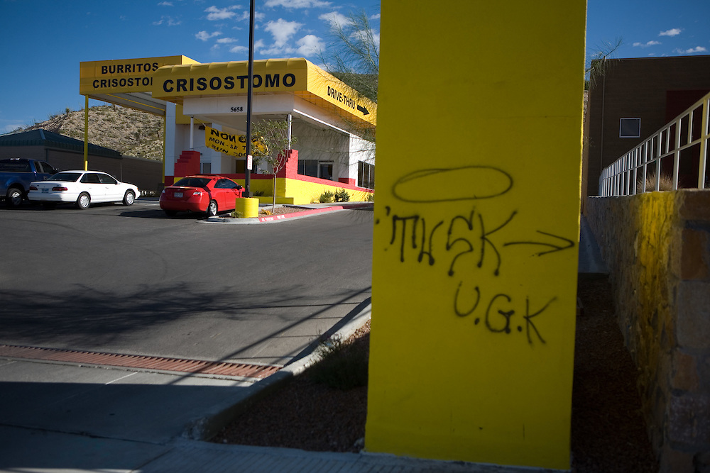 .Grafitti mars the sign for the new Burritos Crisostomo in El Paso Texas on Sunday morning, Oct. 11, 2009..