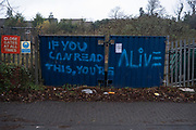 Poetic graffiti in Moseley on 31st December 2020 in Birmingham, United Kingdom. The slogan reads: If you can read this, youre alive.