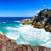 Panoramic shot of the rugged rocky headland of Point Lookout on North Stradbroke Island, Queensland, Australia. Just off the coast of Brisbane, North Stradbroke Island is the world's second largest sand island and a popular holiday destination.