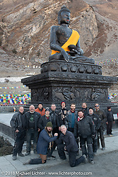 Our group posing under a statue of Buddha at the Buddhist temple above the town of Muktinath on day-6 of our Himalayan Heroes adventure riding from Muktinath to Tatopani, Nepal. Sunday, November 11, 2018. Photography ©2018 Michael Lichter.