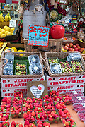 Jersey strawberries and other fruit on sale at St Helier Central Market in historic Victorian market hall, in Jersey, Channel Isles