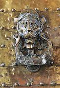 Detail of historic brass door knocker Cordoba, Spain