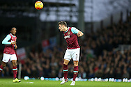 Aaron Cresswell of West Ham United heads the ball. Barclays Premier league match, West Ham Utd v Stoke city at the Boleyn Ground, Upton Park  in London on Saturday 12th December 2015.<br /> pic by John Patrick Fletcher, Andrew Orchard sports photography.