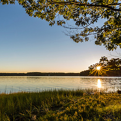 Dawn breaks over Great Bay at Adams Point in Durham, New Hampshire.
