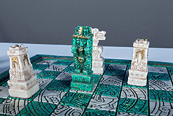 29 March 2014:   carved stone chess set and pieces - made in Mexico.  Studio shot against blue screen