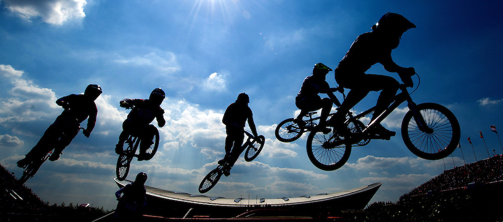 BMX riders take a jump during quarter-final action at the 2012 Summer Olympics in London on Thursday, August 9, 2012. THE CANADIAN PRESS/Sean Kilpatrick