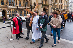 Hundreds of Christians in London take part in the interdenominational Methodist, Anglican and Catholic March of Witness in Westminster. PICTURED: The cross, borne by a member of homeless charity The Passage, is carried into Westminster Abbey.