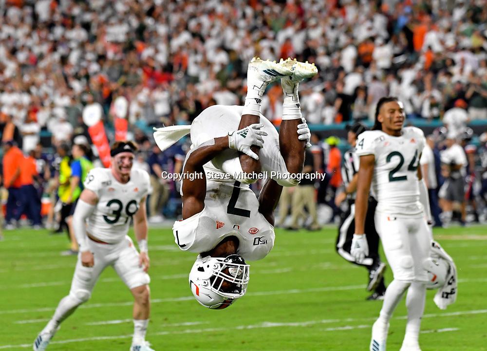 Oct 11, 2019; Miami Gardens, FL, USA; Miami Hurricanes cornerback Al Blades Jr. (7) performs a back flip after defeating the Virginia Cavaliers at Hard Rock Stadium. Mandatory Credit: Steve Mitchell