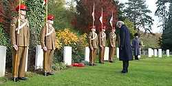 Prime Minister Theresa May at the St Symphorien Military Cemetery in Mons, laying a wreath at the grave of George Ellison, the last British soldier to be killed before Armistice in 1918.