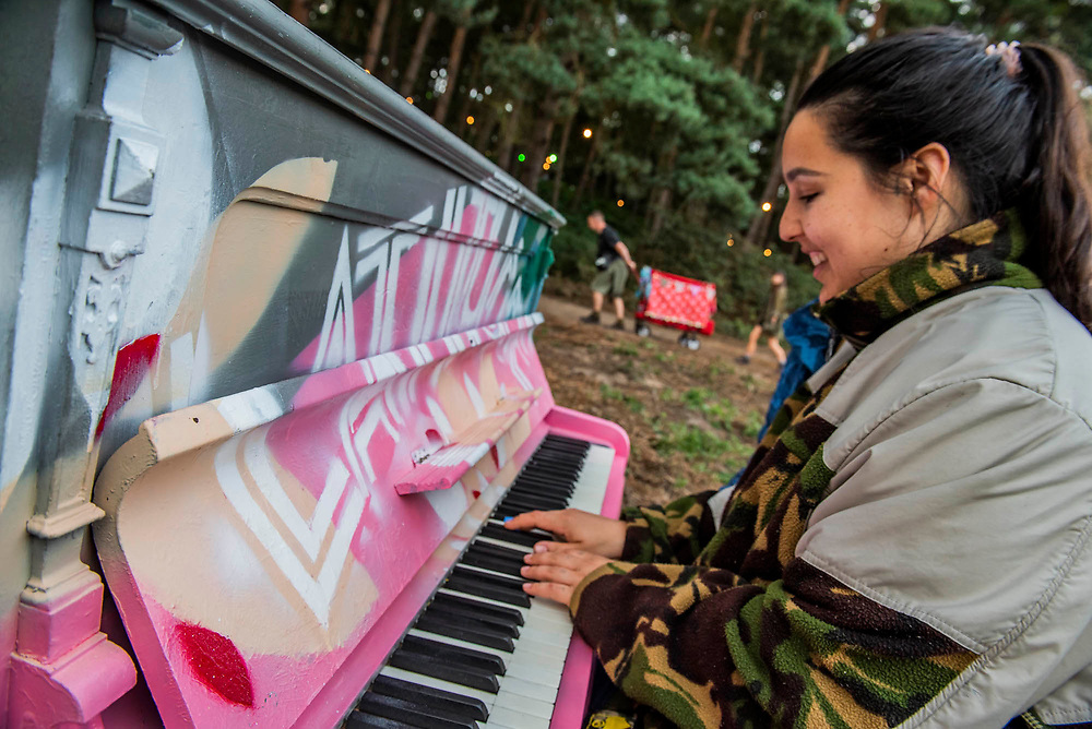 Henham Park, Suffolk, 18 July 2019. A piano on the edge of teh woods for all to paly - The 2019 Latitude Festival.