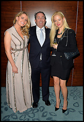 Earl Spencer's daughter Lady Kitty Spencer (left) the Niece of Princess Diana with Liam Fox and  Trustee Belinda McKeeve as they attend Give Us Time event in London, United Kingdom. Wednesday, 27th November 2013. Give us Time is a charity set up for service personnel to have holidays with their families after tours in War zones. Picture by Andrew Parsons / i-Images