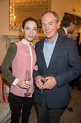 SIR SIMON & LADY JENKINS at a reception to celebrate the publication of Quicksilver by HRH Princess Michael of Kent held at the home of Richard & Basia Briggs, 35 Sloane Gardens, London on 9th November 2015.