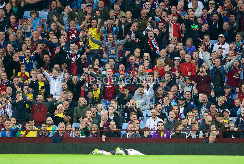 BIRMINGHAM, ENGLAND - Friday, August 14, 2015: Aston Villa supporters jeer after a miss by Manchester United's Morgan Schneiderlin during the Premier League match at Villa Park. (Pic by David Rawcliffe/Propaganda)