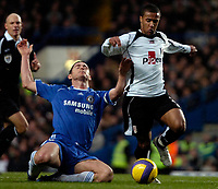 Photo: Ed Godden.<br />Chelsea v Fulham. The Barclays Premiership. 30/12/2006.<br />Chelsea's Frank Lampard (L), is brought to the ground by Wayne Routledge.