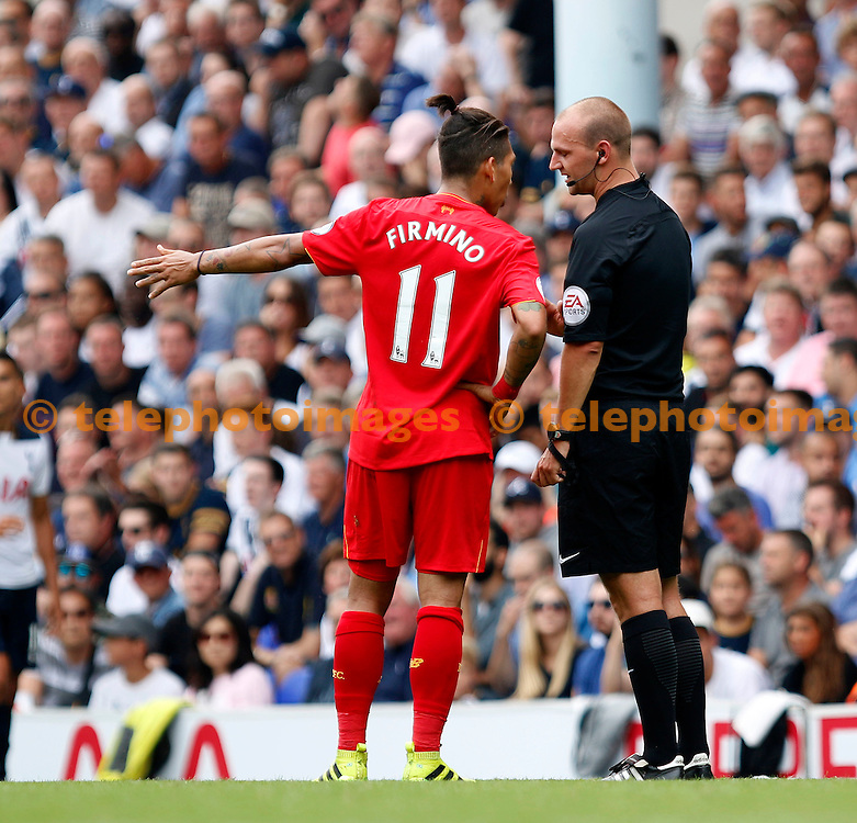 Referee Bobby Madley has words with Liverpool's Roberto Firmino during the Premier League match between Tottenham Hotspur and Liverpool at White Hart Lane in London. August 27, 2016.<br /> Carlton Myrie / Telephoto Images<br /> +44 7967 642437