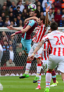 Joe Allen of Stoke battles with Havard Nordtveit of West Ham utd (l). Premier league match, Stoke City v West Ham Utd at the Bet365 Stadium in Stoke on Trent, Staffs on Saturday 29th April 2017.<br /> pic by Bradley Collyer, Andrew Orchard sports photography.