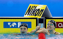 HANGZHOU, Dec. 15, 2018  Olivia Smoliga (R) of the United States reacts after Women's 50m Backstroke Final at 14th FINA World Swimming Championships (25m) in Hangzhou, east China's Zhejiang Province, on Dec. 15, 2018. Olivia Smoliga claimed the title with 25.88 seconds. (Credit Image: © Xinhua via ZUMA Wire)