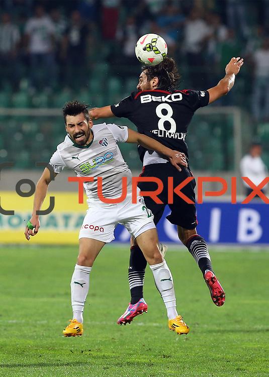 Bursaspor's Aziz Eraltay (L) during the Turkish soccer super league match Bursaspor between Besiktas at the Ataturk Stadium in Bursa Turkey on Monday, 22 September 2014. Photo by TURKPIX