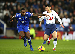 Leicester City's Wes Morgan (left) and Tottenham Hotspur's Son Heung-min battle for the ball during the Premier League match at the King Power Stadium, Leicester.