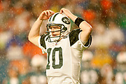 New York Jets quarterback Chad Pennington looks to the bench during a downpour during the New York Jets 13-10 victory over the Miami Dolphins on December 25, 2006 at Dolphins Stadium in Miami, Florida.