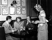 1949 (L to R) Robert Cobb (owner of the Brown Derby), Rita Hayworth and Paul Whitman