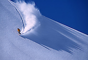 Phillippe Bataille ripping the Chamonix powder on the Glacier of Argentiere in the Massif du Mont Blanc, France.