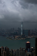 Hong Kong - September 1, 2019: Storm clouds  hover over Hong Kong's city skyline, viewed from Victoria Peak.
