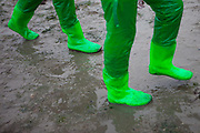 """Visitors with hip long rubber boots on the open """"Mysterious Sea Road"""" at Hoedong shore (Jindo island). Jindo is the 3rd biggest island in South Korea located in the South-West end of the country and famous for the """"Mysterious Sea Route"""" or """"Moses Miracle"""". Every spring thousands flock to the shores of Jindo to walk the mysterious route that stretches roughly three kilometers from Hoedong to the distant island of Modo. Materializing from the rise and fall of the tides, the divide can reach as wide as forty meters."""