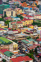 Brightly colored old fashioned colonial style buildings, Phnom Penh, Cambodia.