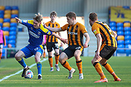 AFC Wimbledon midfielder Jack Rudoni (12) battles for possession during the EFL Sky Bet League 1 match between AFC Wimbledon and Hull City at Plough Lane, London, United Kingdom on 27 February 2021.
