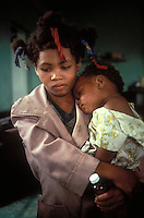 girl with her little sister, at an emergency clinic in the Dominican Republic during the aftermath of Hurricane David, 1978