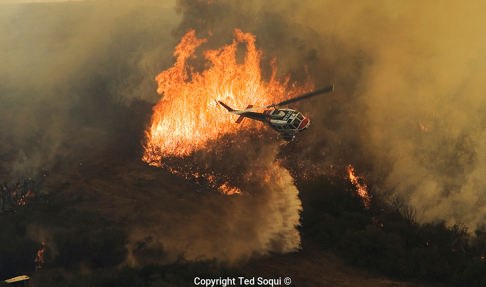 Helicopter water drop near the Lake Hodges area of San Diego..San Diego area wild fires.