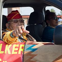 Navajo Code Talker Joe Vandever waves to parade-goers during the Navajo Code Talkers Parade in Window Rock, AZ on Aug. 14, 2018.