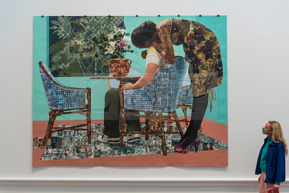 """© Licensed to London News Pictures. 28/09/2020. LONDON, UK. A staff member poses with """"Blend In - Stand Out"""" by Njideka Akunyili Crosby.  Preview of the Summer Exhibition at the Royal Academy of Arts in Piccadilly which, due to the Covid-19 lockdown, is taking place for the first time in the autumn.  Over 1000 works in a range of media by Royal Academicians, established and emerging artists, feature in the exhibition which runs from 6 October 2020 – 3 January 2021.  Photo credit: Stephen Chung/LNP"""
