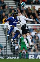 Photo: Steve Bond.<br /> Derby County v Everton. The FA Barclays Premiership. 28/10/2007. Joseph Yobo (L) challanges Kenny Miller (R)