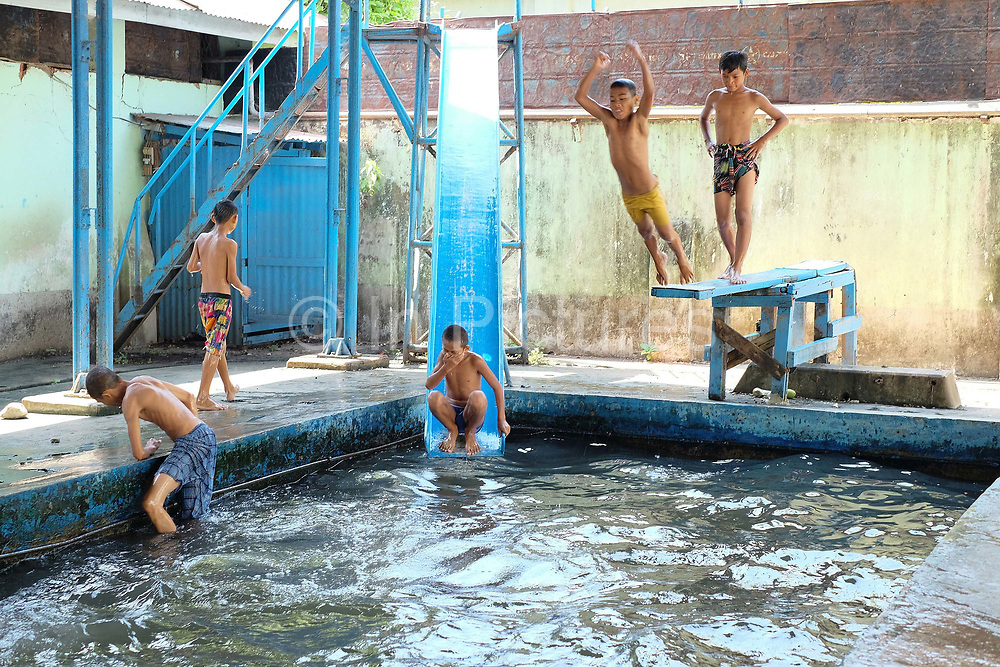 Boys having fun at a small indoor swimming pool in Insein, a suburb of Yangon on 17th May 2016 in Myanmar