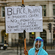 A man wearing protective equipment joined Black Lives Matter protestors near Downing Street during a demonstration in Parliament Square in London on Wednesday, June 3, 2020, over the death of George Floyd, a black man who died after being restrained by Minneapolis police officers on May 25. Protests have taken place across America and internationally after a white Minneapolis police officer pressed his knee against Floyd's neck while the handcuffed black man called out that he couldn't breathe. The officer, Derek Chauvin, has been fired and charged with murder. (Photo/ Vudi Xhymshiti)