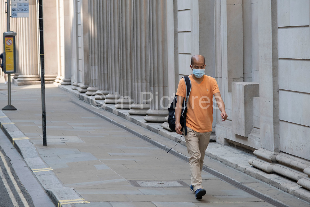 As Britain enters a period of deep recession, as the economic downturn caused by the Covid-19 pandemic cuts hard, the area around the Bank of England remains incredibly quiet, with just a few people walking around this normally busy part of the financial district on 12th August 2020 in London, United Kingdom. The Office for National Statistics / ONS has announced that gross domestic product / GDP, the widest gauge of economic health, fell by 20.4% in the second quarter of the year, compared with the previous quarter. This is the biggest decline since records began. The result is that Britain has officially entered recession, as the UK economy shrank more than any other major economy during the coronavirus outbreak.