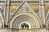 Close up of the main door with mosaics depicting the the Virgin Mary created between 1350 and 1390 after designs by artist Cesare Nebbia and sculpture of the Madonna and Child created by Andrea Pisano in 1347  on the14th century Tuscan Gothic style facade of the Cathedral of Orvieto, designed by Maitani, Umbria, Italy .<br /> <br /> Visit our ITALY HISTORIC PLACES PHOTO COLLECTION for more   photos of Italy to download or buy as prints https://funkystock.photoshelter.com/gallery-collection/2b-Pictures-Images-of-Italy-Photos-of-Italian-Historic-Landmark-Sites/C0000qxA2zGFjd_k<br /> .<br /> <br /> Visit our MEDIEVAL PHOTO COLLECTIONS for more   photos  to download or buy as prints https://funkystock.photoshelter.com/gallery-collection/Medieval-Middle-Ages-Historic-Places-Arcaeological-Sites-Pictures-Images-of/C0000B5ZA54_WD0s