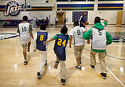 Utah Jazz point guard Mo Williams, center right, looks on as at-risk youth from the Dream Academy perform warm-up exercises during a basketball clinic at the Zions Bank Basketball Center, Wednesday, Oct. 24, 2012.
