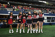 The Iraan High School cheerleaders look on during the state championship game at AT&T Stadium in Arlington, Texas on December 15, 2016. (Cooper Neill for The New York Times)