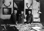 World War I: Wilhelm II of Germany studying maps with his senior commanders General Hindenburg, left, and General Ludendorf, right.