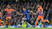 Football - 2016 / 2017 Premier League - Chelsea vs. Manchester City<br /> <br /> Pedro of Chelsea cuts between Fabian Delph and Nolito of Manchester City at Stamford Bridge.<br /> <br /> COLORSPORT/DANIEL BEARHAM